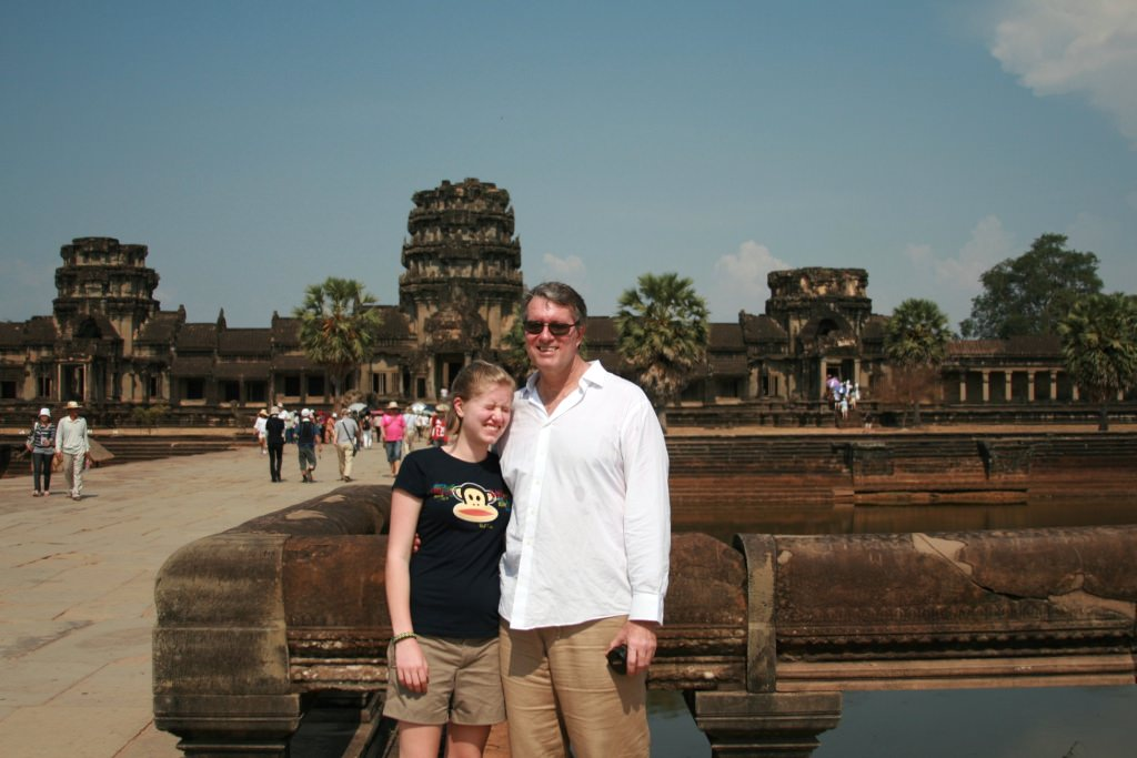 I cruised the Mekong River with my daughter. Yes, next time she should wear sunglasses at Angkor Wat.