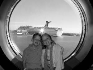 Ralph Grizzle's kids on Disney Wonder, with a Carnival Cruise Lines vessel in the background.