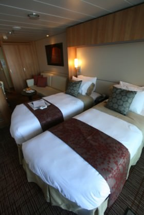 Earth tones and pleasant colors make for a relaxing stateroom.