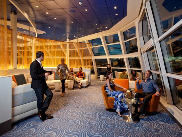 Amble up to the futuristic Observation Lounge for a nightcap. Photo courtesy of Celebrity Cruises.