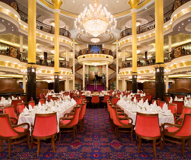 The stunning three-story dining room aboard Freedom of the Seas. Photo courtesy of Royal Caribbean