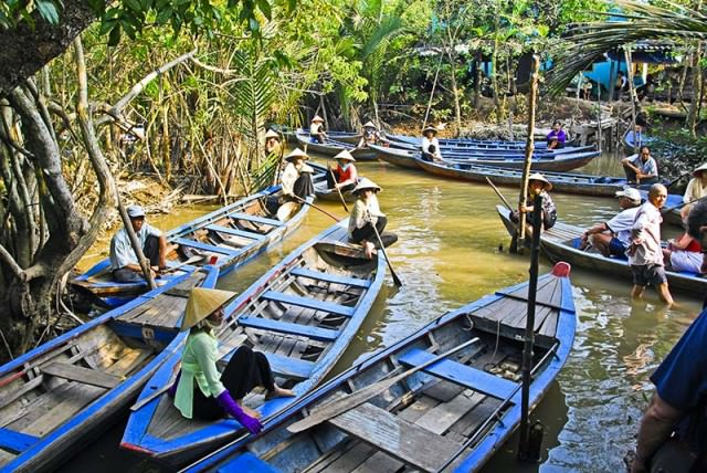 Small boats that take tourists down narrow channels in Mekong Delta of Vietnam