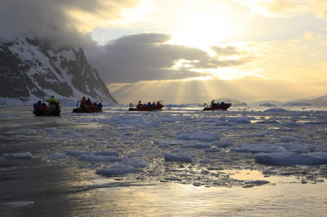 An expedition to Antarctica is like no other voyage in the world. Here, guests of Norwegian-based Hurtigruten set out from the Fram on Zodiacs near the Lemaire Channel. Photo courtesy of Hurtigruten ASA.
