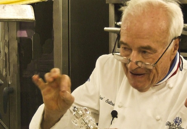 Andre Soltner explains a point in cooking class on Crystal Serenity