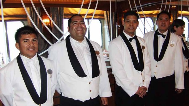 Crystal Serenity waiters greet guests in dining room