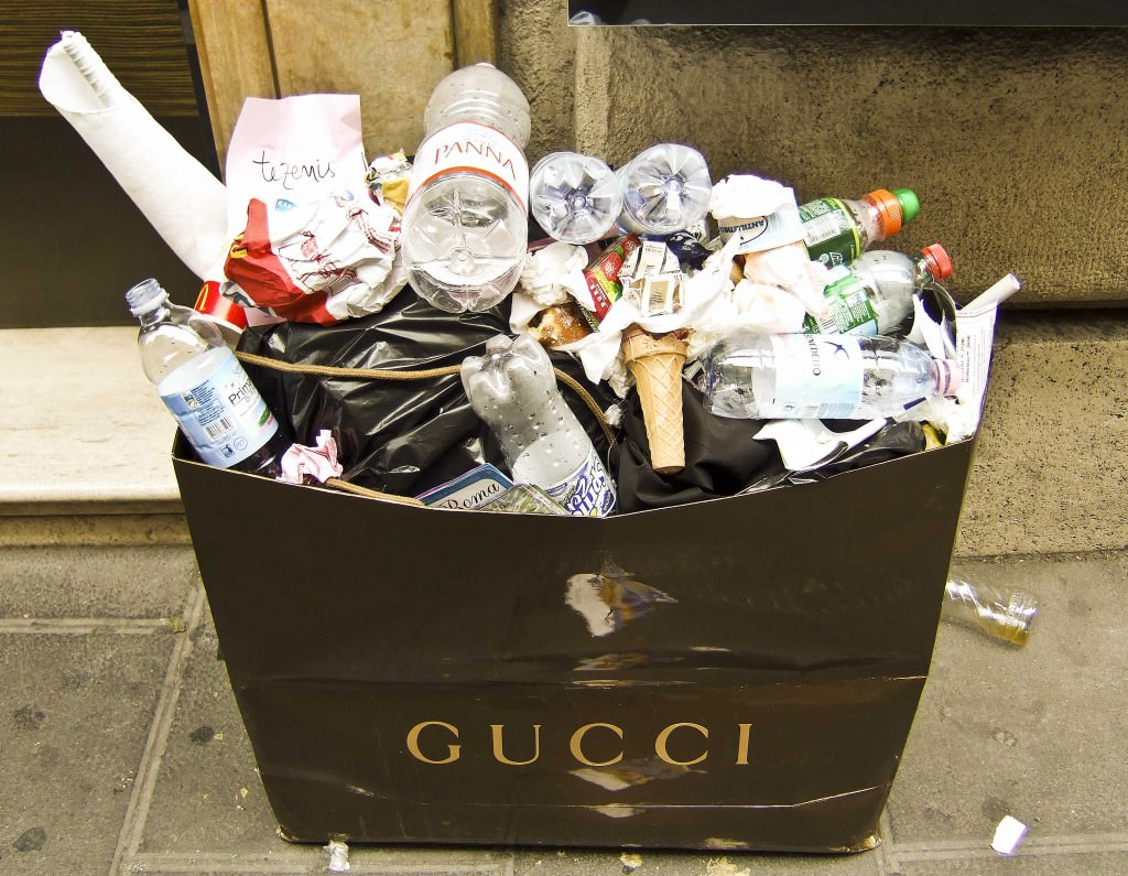 A Gucci bag becomes a trash container in Rome