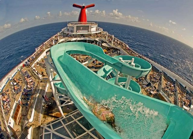 Girl begins a trip down Carnival Liberty's water slide