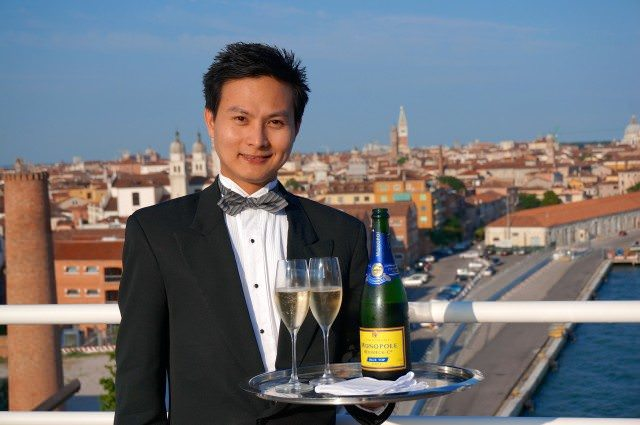 Champagne served in Venice by our butler Rodolfo. © 2013 Ralph Grizzle