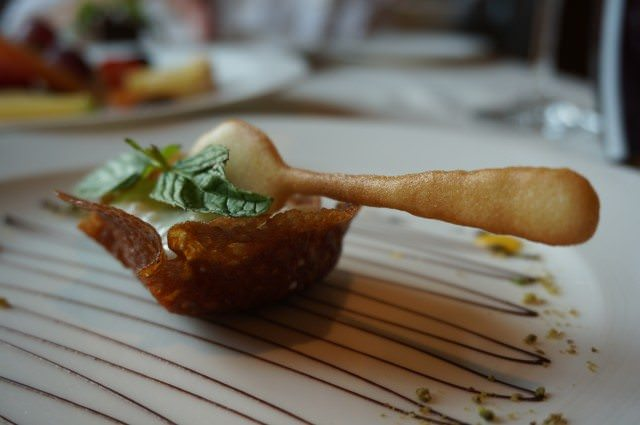 Dessert in the main dining room: rice pudding, served with an edible spoon and bowl. © 2013 Ralph Grizzle