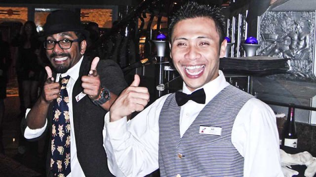 Waiter and magician entertain at dinner on Carnival Liberty