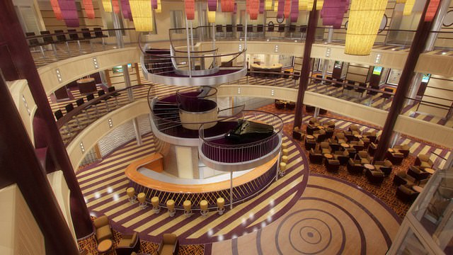The spectacular Atrium aboard Carnival Breeze reflects the new color palette chosen for this innovative ship. Rendering courtesy of Carnival.
