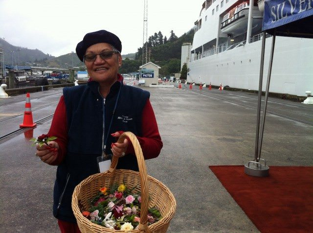 In Picton, New Zealand, local ladies greet cruise passengers with flowers picked from their gardens.