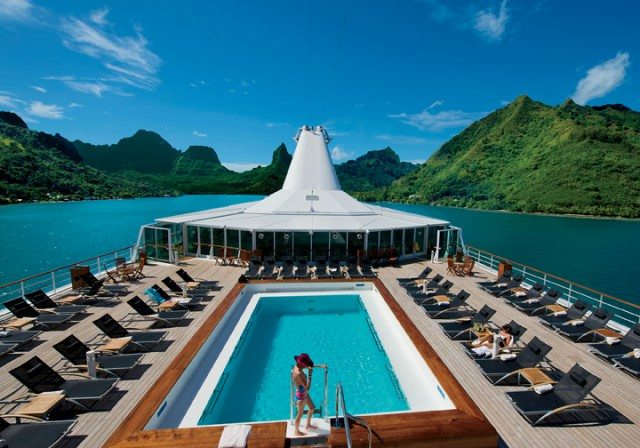 The spacious pool deck of the Paul Gauguin is perfect for soaking in the Tahitian sun. Photo courtesy of Paul Gauguin Cruises