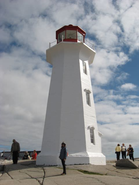The iconic lighthouse at Peggy's Cove, Nova Scotia casts a watchful eye across the Atlantic. Photo © Aaron Saunders