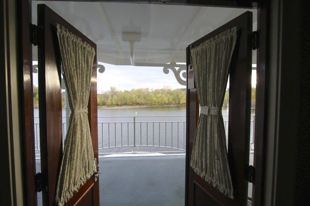 French doors open onto the Mississippi River from stateroom 311 on the American Queen. © 2012 Ralph Grizzle