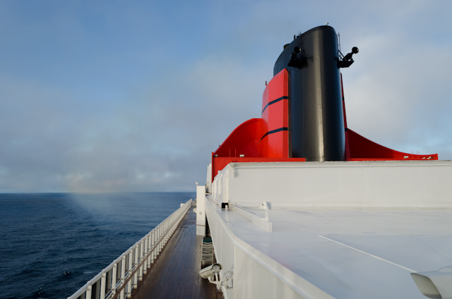 A beautiful sight: the Queen Mary 2's funnel on a gorgeous morning, with Hurricane Sandy far behind us. Photo © 2012 Aaron Saunders