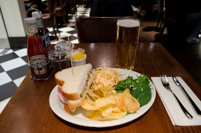 Spending some quality time at London's Heathrow Airport on my long journey home, made better by an English pub lunch. Photo © 2013 Aaron Saunders