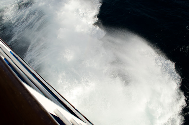 A particularly large wave breaks over the Silver Wind's bow as we sailed the Indian Ocean. Photo © 2013 Aaron Saunders