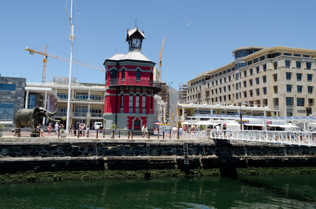 "The historic Clock Tower, adjacent to the Robben Island ferry and the aptly-named ""Swing Bridge."" Photo © 2013 Aaron Saunders"