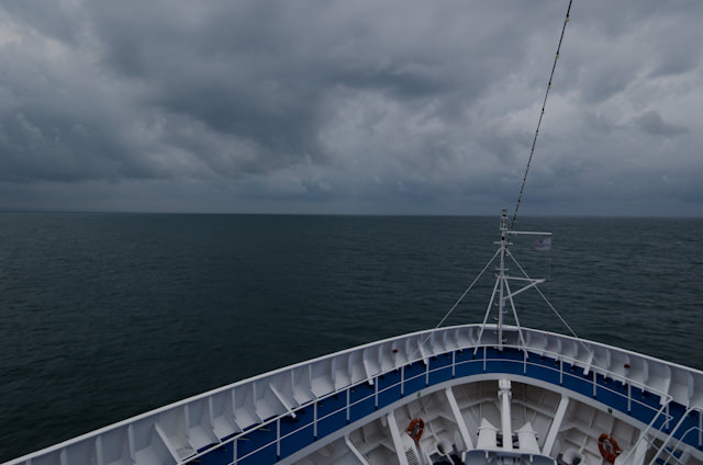 A Gathering Storm: skies darken as we head into the dinner hour aboard the Silver Wind. Lightning and heavy rain would accent the evening, making our elegant vessel seem even more inviting. Bouillon