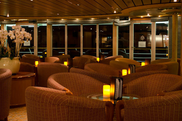 THe beautiful Panorama Lounge at night, located aft on Deck 8. Photo © 2013 Aaron Saunders