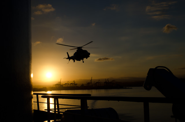 Action on the High Seas: preparing to disembark our pilot via helicopter. Photo © 2013 Aaron Saunders