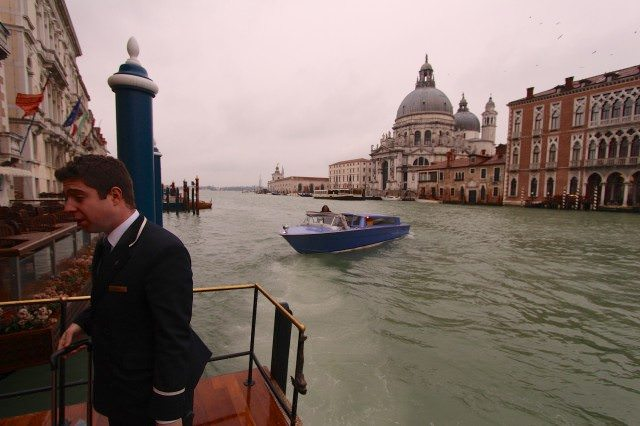 Saying good-bye to the water taxi on Venice's Grand Canal as the bellboy handles my one bag. ©2013 Ralph Grizzle