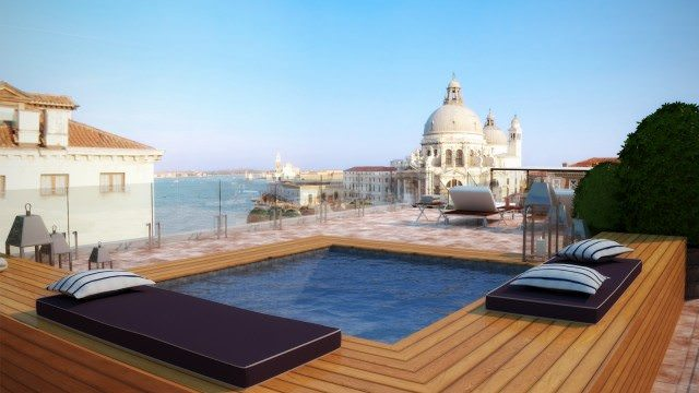 The Redentore Terrazza Suite overlooks Santa Maria della Salute Basilica, with views to the Giudecca island and Palladio's masterpiece, the Church of the Redentore. The terrace has a mini pool as well as chaise lounges and furniture for outdoor comfort and entertaining. photo courtesy The Gritti Palace