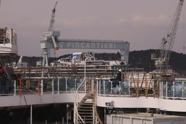 From the top deck on Royal Princess, we sighted Regal Princess, identifiable by the Princess Sea Witch logo just under the Fincantieri crane structure. © 2013 Ralph Grizzle