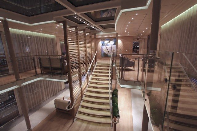 Viking Bragi made its debut in March 2013 and features decorative wood slats along the staircase. Compare to the lighted marble slabs  on the Viking Aegir, launched in August 2012. ©2013 Ralph Grizzle