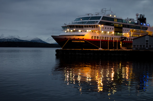 Hurtigruten's Midnatsol on a brilliant winter's evening in Norway. Photo © 2013 Aaron Saunders