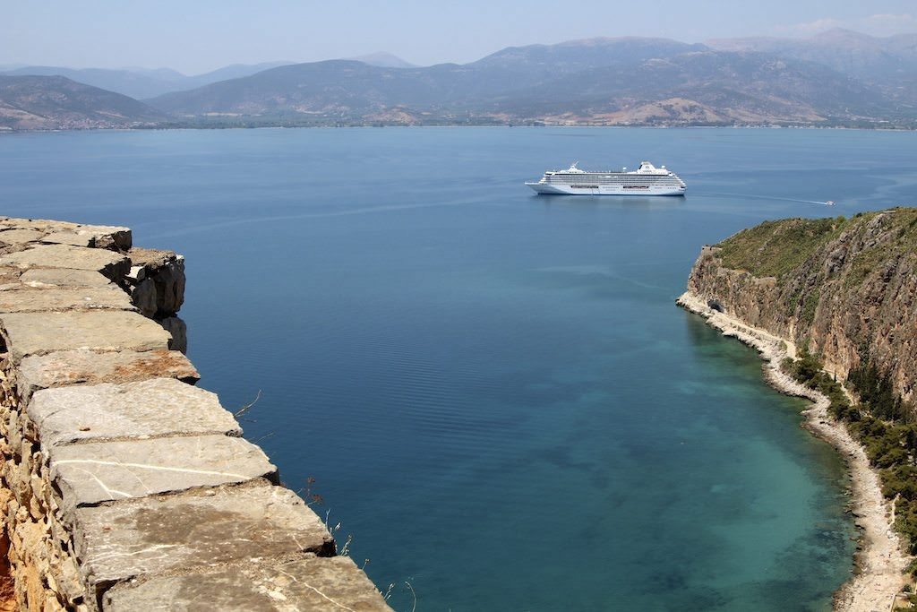 Crystal Serenity, anchored off the coast of Nafplion, Greece, will commence 2015 world cruise. © Ralph Grizzle