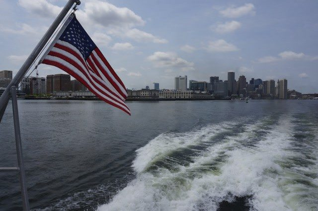 The city of Boston in our wake as we set sail for Provincetown on a shore excursion. © 2013 Ralph Grizzle