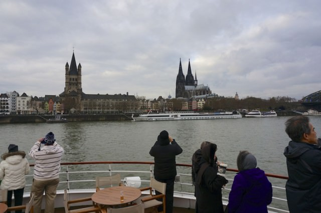 Snap, snap: On deck for photos as we cruise into Cologne. © 2013 Ralph Grizzle