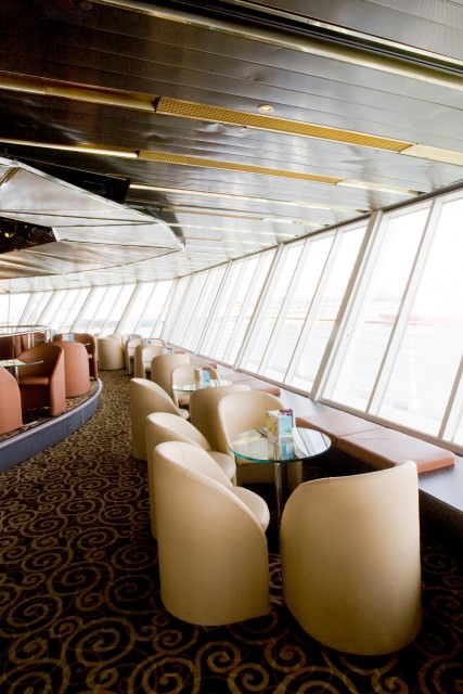 Located high atop the ship, the Stars Lounge wraps around the base of the funnel aboard Louis Cristal. Photo courtesy of Cuba Cruise