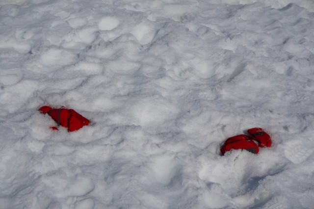Those who became too warm were told they could cache their parkas — partially submerged under the snow so that the wind would not blow them away. © 2013 Ralph Grizzle