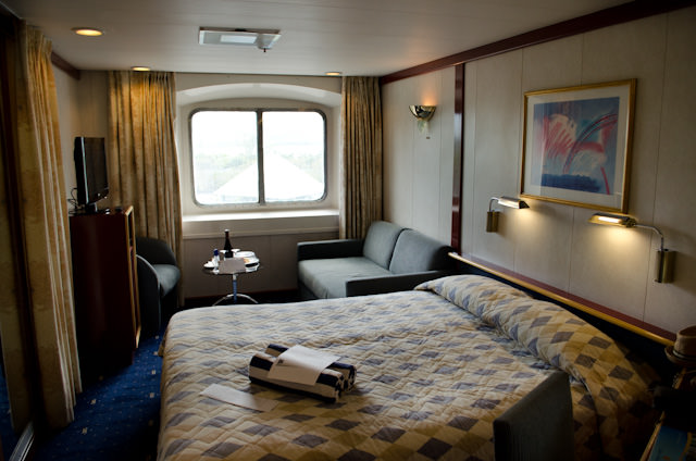 My Category XF Deluxe Oceanview stateroom on Deck 7. It may not have a balcony, but the sitting area is a fantastic feature. Photo © 2014 Aaron Saunders