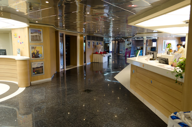 Louis Cristal's bright and inviting Reception Desk on Deck 5 handles check-in. Photo © 2014 Aaron Saunders