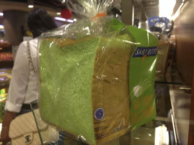 Inexplicably green bread at the shopping mall in Jakarta. © 2014 Ralph Grizzle