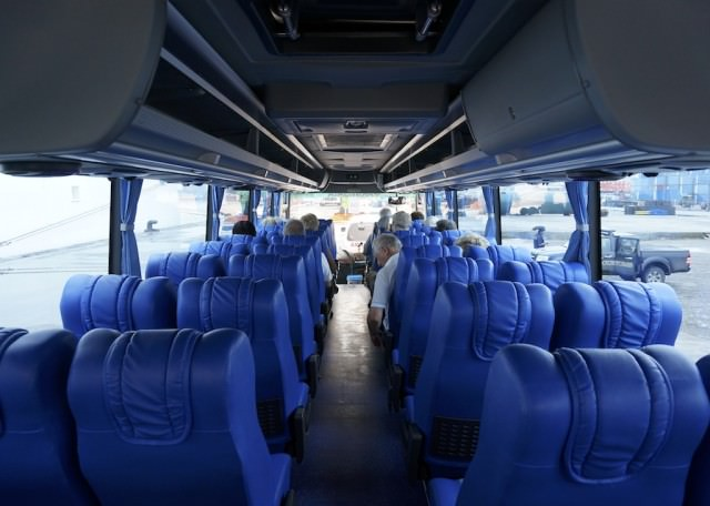 Silversea doesn't crowd guests on motor coaches. Our bus could seat 45, but when all were boarded, there were only 23 of us. Motor coaches are air-conditioned and drinking water is provided (along with soft drinks today on our tour). © 2014 Ralph Grizzle