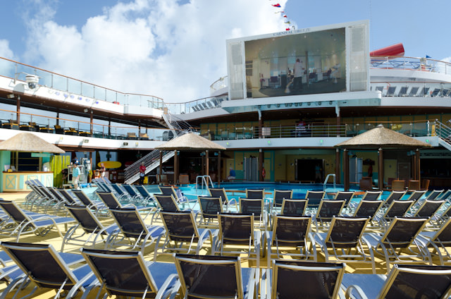 The pool deck aboard Carnival Breeze, bathed in the warmth of the Miami sun. Photo © 2014 Aaron Saunders