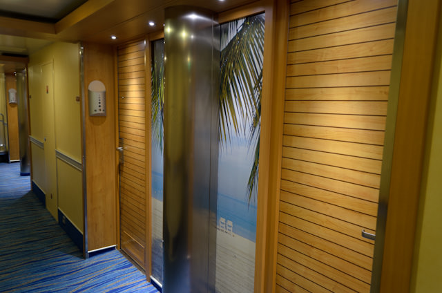 One look at the stateroom corridors, with their vibrant Caribbean theme, is all it takes to know Carnival has chosen a new interior decor design path with Carnival Breeze. Photo © 2014 Aaron Saunders