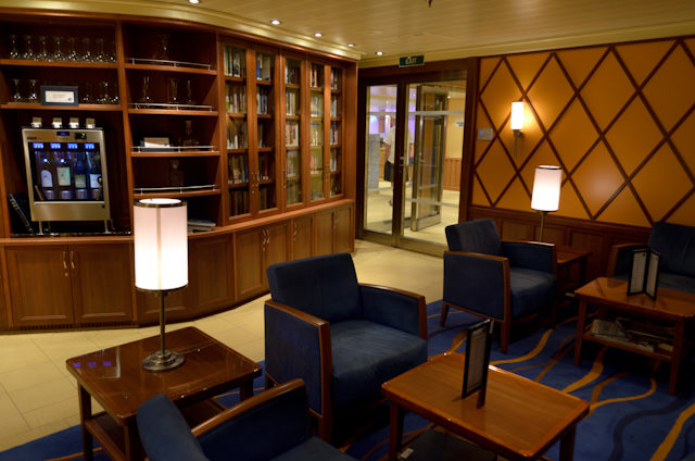 The Library Bar looks like it would be right at home on Cunard. It's also one of the calmest, quietest spots onboard, and there's a decent selection of books. Photo © 2014 Aaron Saunders