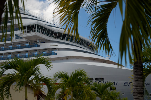 The bow of the Carnival Breeze peeks through the palm trees in St. Thomas, US Virgin Islands. Photo © 2014 Aaron Saunders