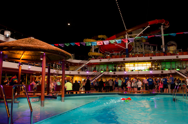 Another pool party - this one sporting a Mexican theme - in full swing up on Deck 10. Photo © 2014 Aaron Saunders