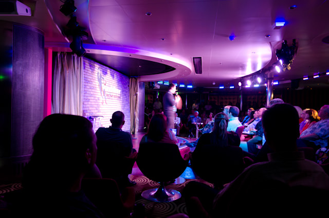 Enjoying evening comedy in the Punchliner Comedy Club aboard Carnival Breeze. Photo © 2014 Aaron Saunders