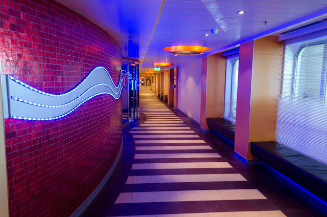 Deck 4 aboard Carnival Breeze has a neat corridor running along the starboard side that provides access to numerous public rooms. Photo © 2014 Aaron Saunders