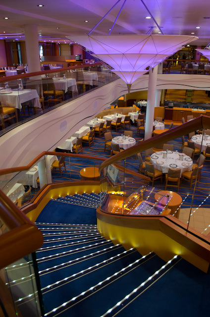 The two-story Sapphire Dining Room is one of two main restaraunts onboard Carnival Breeze. Photo © 2014 Aaron Saunders