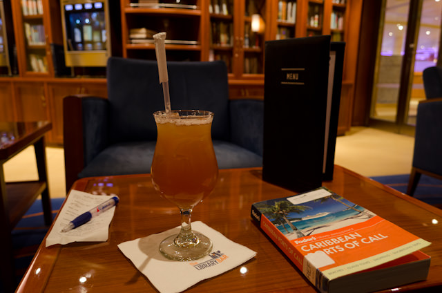 Making myself quite comfortable in Carnival Breeze's Library Bar on Deck 4. Photo © 2014 Aaron Saunders