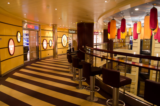 Shops aboard Carnival Breeze are located on Deck 5, clustered around the ships' atrium. Photo © 2014 Aaron Saunders